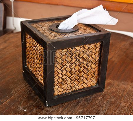 Tissue box on a wooden table in the resort..