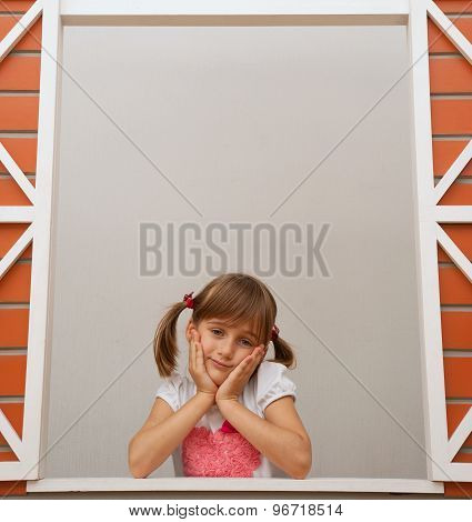 kid in window