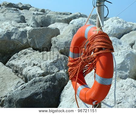 Orange Jackets With Rope To Rescue Swimmers In The Sea