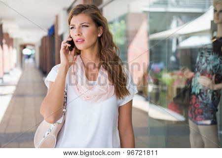 Woman calling with smartphone at the shopping mall