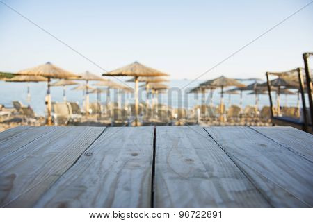 Wooden Table With Beach Background