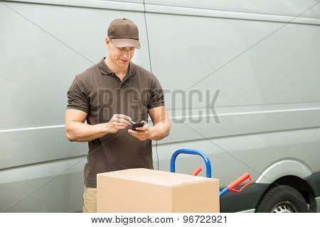 Delivery Man Checking List On Mobile Phone