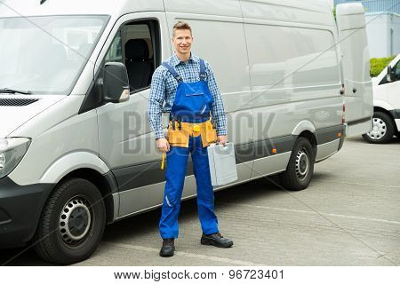 Repairman With Tools And Toolbox In Front Of Van