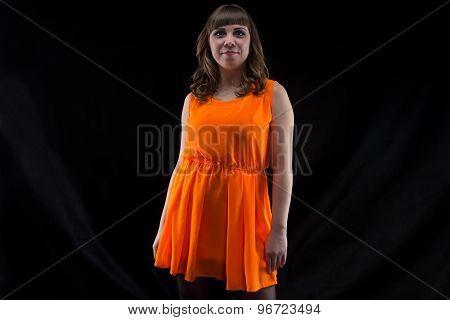 Image of plump woman in orange dress
