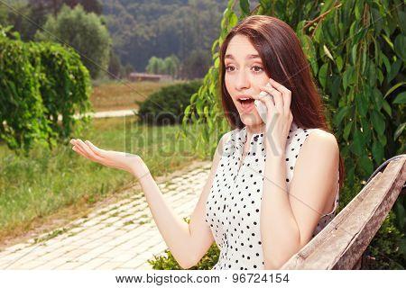 Vivacious girl holding mobile phone
