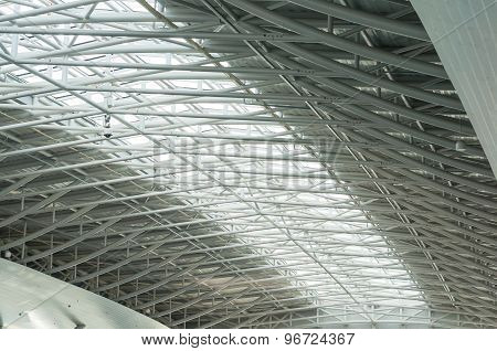 metal and glass roof of a huge empty hangar. architecture detail