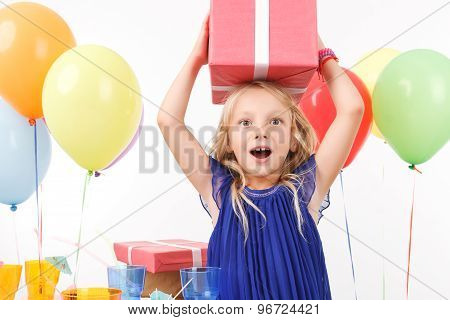 Cheerful girl holding present box