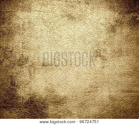 Grunge background of deep champagne leather texture