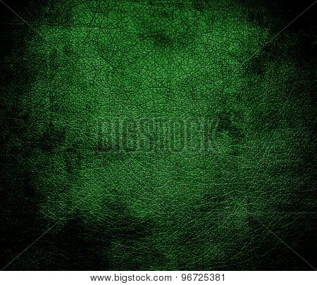 Grunge background of deep green leather texture