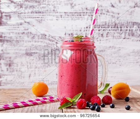Summer Fruits And Berries Smoothie In A Glass Mug