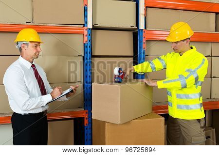 Manager With Clipboard And Worker Taping Box