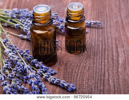 Two Bottles Of Aroma Oils And Lavender Flowers