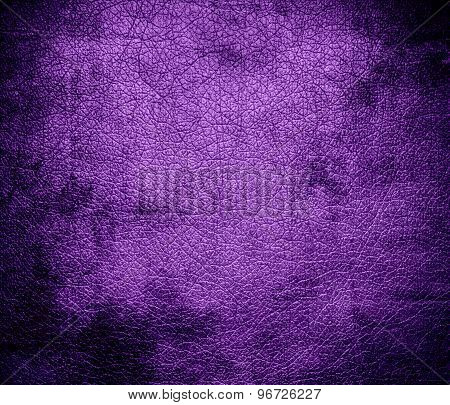 Grunge background of deep lilac leather texture