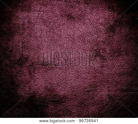 Grunge background of deep ruby leather texture