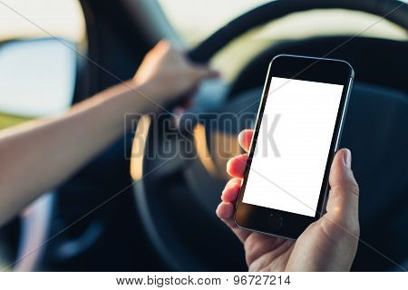Woman using phone in the car