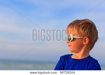 little boy on summer sea beach