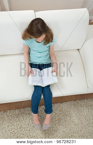 Girl On Sofa Reading Book
