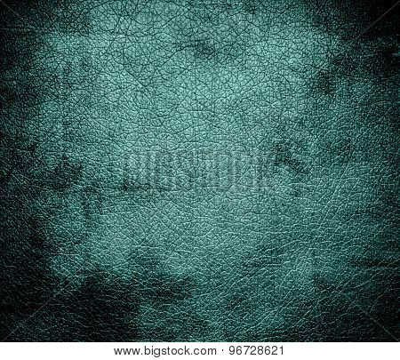 Grunge background of desaturated cyan leather texture