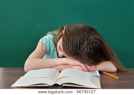 Student Sleeping At Desk
