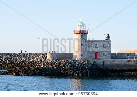 Lighthouse And Harbour In Howth