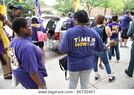 Activists with Time is Now shirts