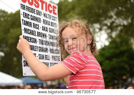Young activist with sign in Cadman Plaza