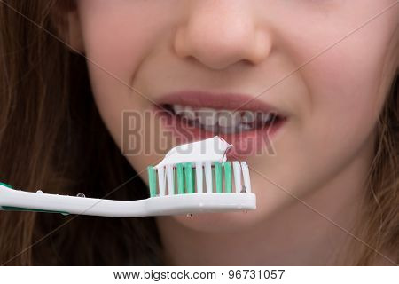 Close-up Of Girl Brushing Teeth