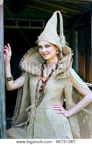 Ancient Medieval woman in costume from gunny sacking