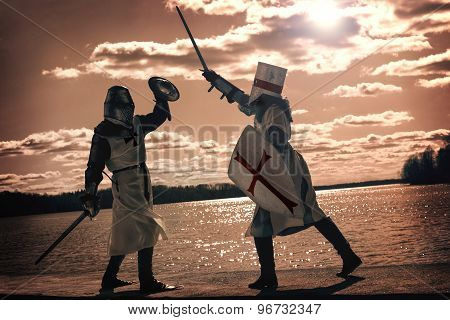 Ancient mystic knights battle outdoors at the river