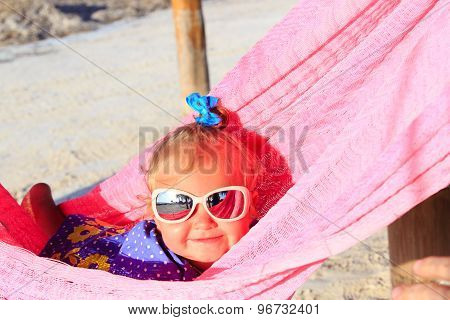 happy little girl relaxed in hammock