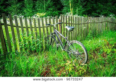 Bike Sticking In The Fence