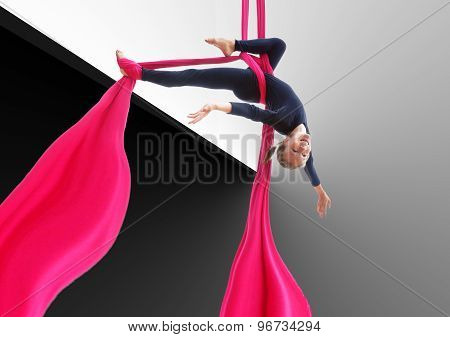 Child Hanging Upside Down On Aerial Silks