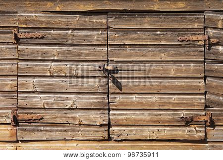 Old Rural Brown Wooden Gate With Padlock