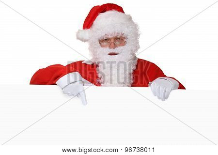 Santa Claus With Beard Pointing On Christmas At Empty Banner With Copyspace