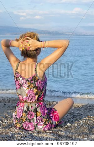 Girl Relaxing With The View At The Sea