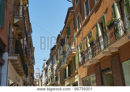 VERONA, ITALY - JULY 11: Via Mazzini with Lamberti Tower in the far background. July 11, 2015 in Verona. Via Mazzini is one of the main commercial streets in Verona.