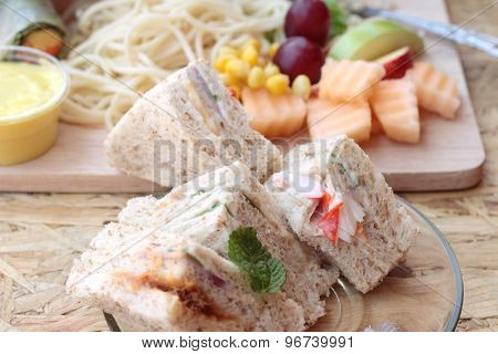 Club Sandwich And Pasta Spaghetti With Salad Mix Fruit