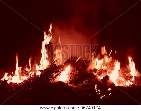 Embers burning in fire at night