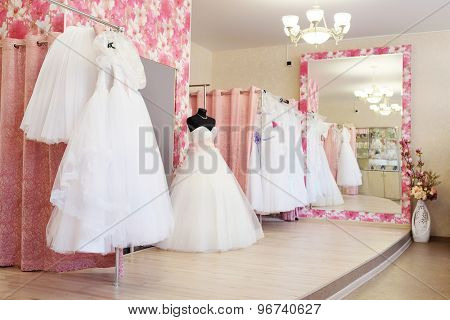 Wedding dresses in a show-room of a wedding salon