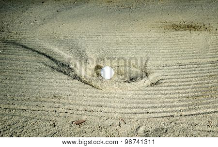 Golf Ball Hitting The Sand Bunker