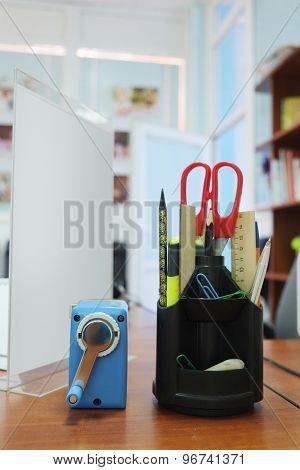 Office supplies including a scissors, sharpener