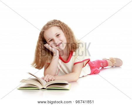 The girl lies on the floor and reading a book