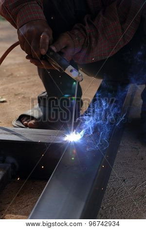 Hand Of Worker Welding Metal