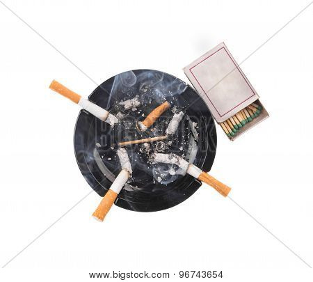 Black ashtray and smoking cigarettes.
