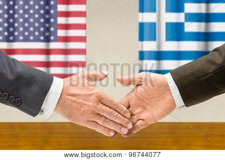 Representatives Of The Usa And Greece Shake Hands
