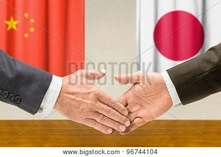 Representatives Of China And Japan Shake Hands