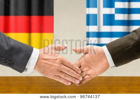 Representatives Of Germany And Greece Shake Hands