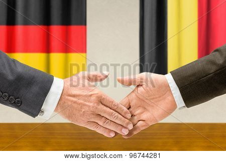 Representatives Of Germany And Belgium Shake Hands