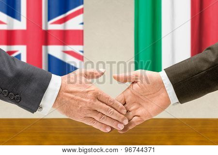 Representatives Of The Uk And Italy Shake Hands