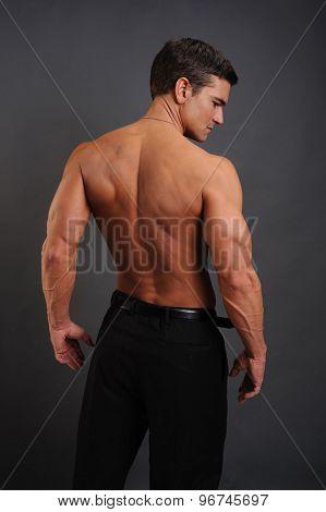 cowboy flexing his back